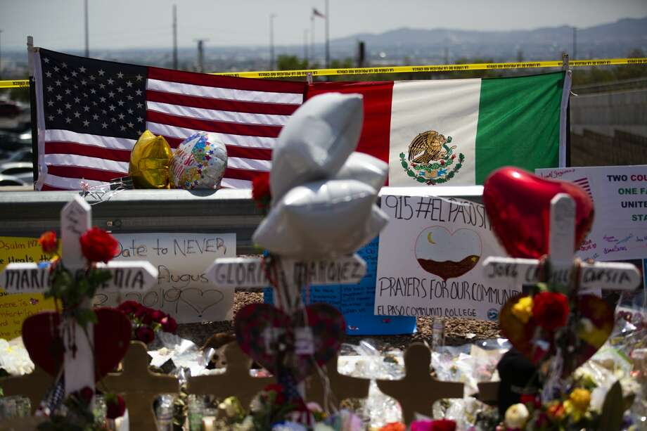 The United States flag and the Mexican flag are placed next to each other at the makeshift memorial that honors the victims of the El Paso shooting. Photo: Marie D. De Jesús/Staff Photographer