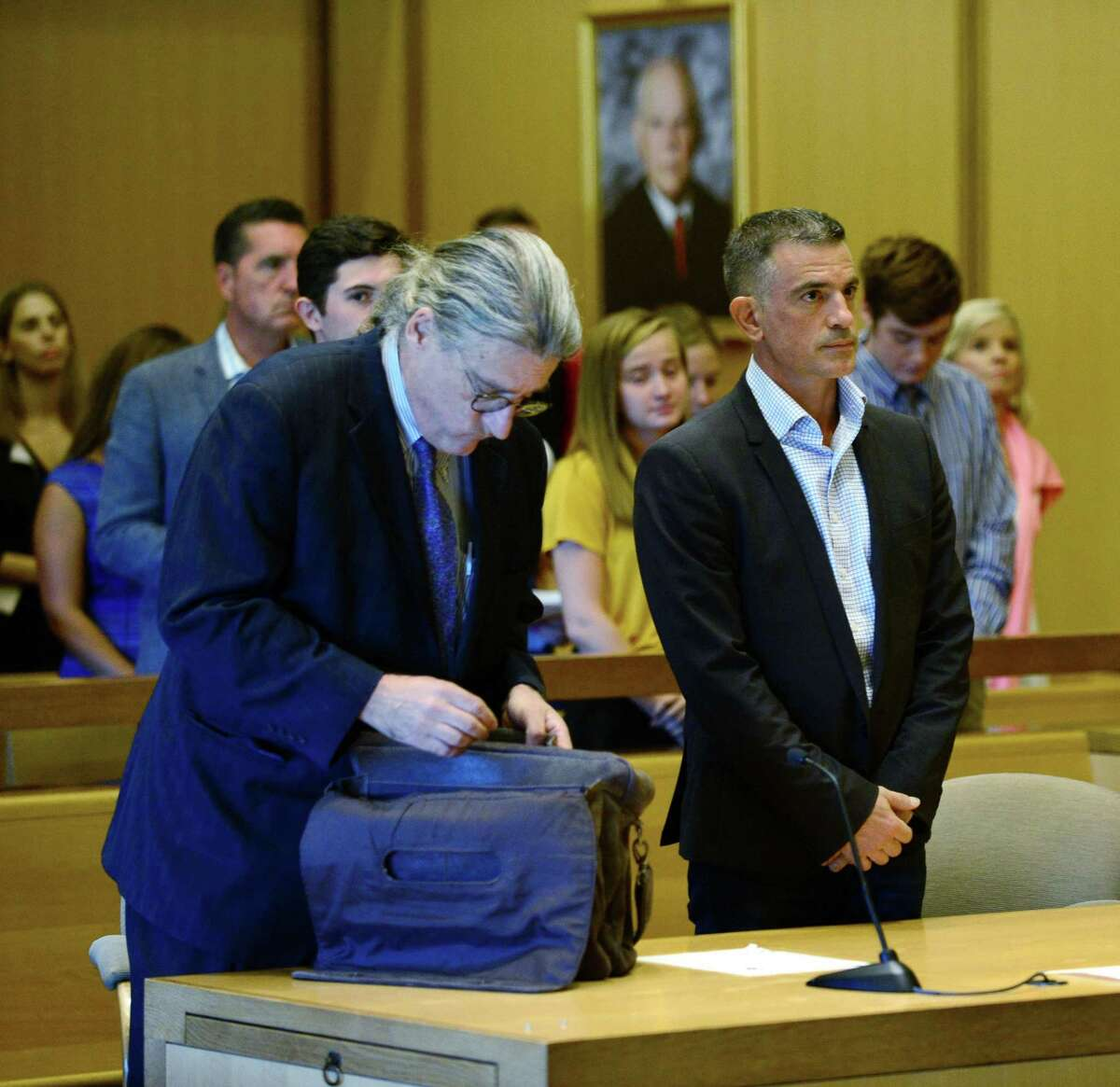 Fotis Dulos, charged with tampering with evidence and hindering prosecution in connection with his wife's disappearance, appears in Stamford Superior Court with his attorney Norm Pattis, left, Friday, August 9, 2018, in Stamford, Conn.