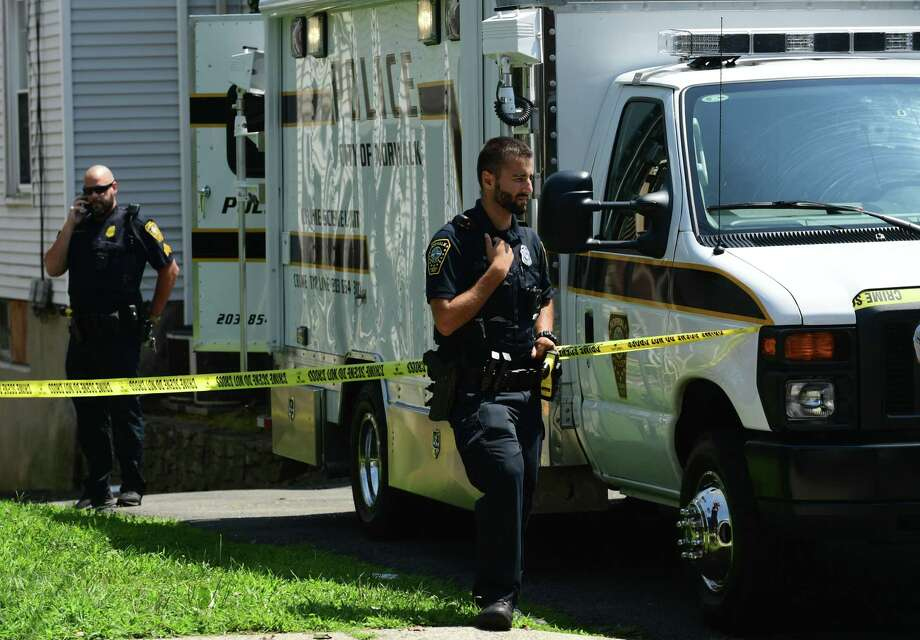 Norwalk police collect evidence as they investigate a fatal stabbing at 69 Fairfield Ave. Thursday, August 8, 2019, in Norwalk, Conn. Photo: Erik Trautmann / Hearst Connecticut Media / Norwalk Hour