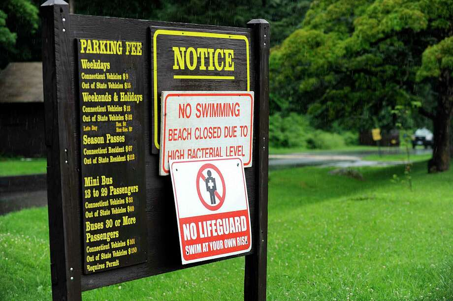File photo of no swimming signs at Squantz Pond State Park in New Fairfield. Photo Friday, July 7, 2017. Photo: Carol Kaliff / Hearst Connecticut Media / The News-Times