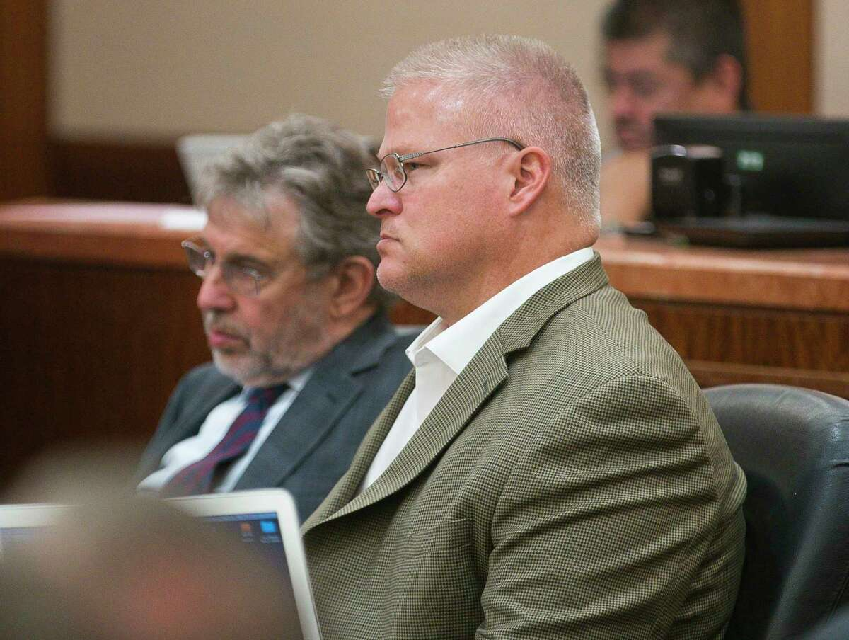 Defense attorney Stanley Schneider and David Temple listen to an argument by the prosecution during the sentencing phase of the trial of Temple, who was found guilty Tuesday of killing his wife in 1999, at the Harris County Criminal Courts building in downtown Houston, Wednesday, Aug. 7, 2019. Temple was originally convicted of the crime during a 2007 trial, but the conviction was overturned by an appeals court nearly 10 years later.
