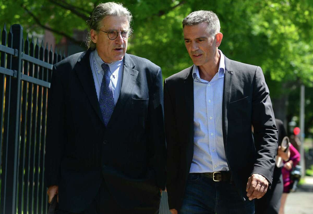 Fotis Dulos, charged with tampering with evidence and hindering prosecution in connection with his wife's disappearance, exits Stamford Superior Court with his attorney Norm Pattis, left, Friday, August 9, 2018, in Stamford, Conn.
