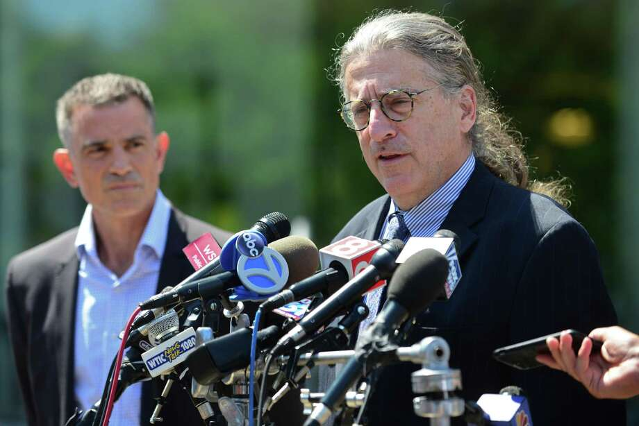 Fotis Dulos, charged with tampering with evidence and hindering prosecution in connection with his wife's disappearance, exits state Superior Court in Stamford with his attorney Norm Pattis, right, who speaks to the press Aug. 9. Photo: Erik Trautmann / Hearst Connecticut Media File Photo / Norwalk Hour