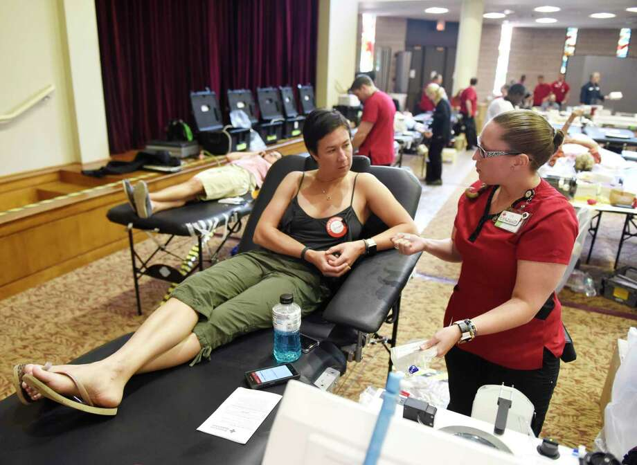 Stamford's Ilona Miller chats with Collections Specialiast Jackie O'Connor before donating blood at the American Red Cross Blood Drive at Temple Sholom in Greenwich, Conn. Monday, Aug. 5, 2019. The Red Cross offered $5 Amazon gift cards to those who donated blood, as the organization faces a continuing shortage. Prospective donors can make an appointment by using the Red Cross Blood Donor App, visiting RedCrossBlood.org, or calling 1-800-RED CROSS (1-800-733-2767). Photo: Tyler Sizemore / Hearst Connecticut Media / Greenwich Time