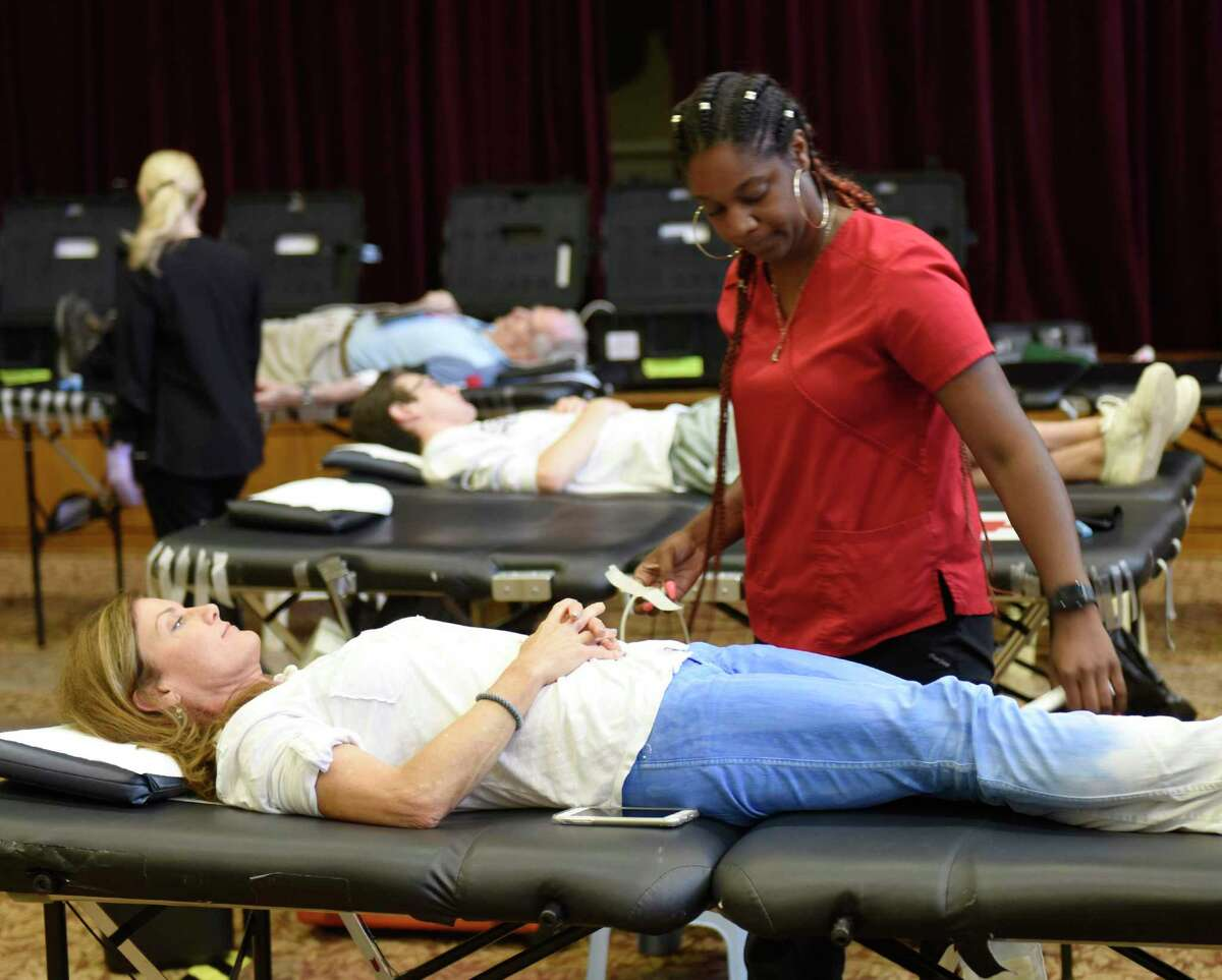 Greenwich's Margery Scotti donates blood with assistance from Collections Specialiast Summer Love at the American Red Cross Blood Drive at Temple Sholom in Greenwich, Conn. Monday, Aug. 5, 2019. The Red Cross offered $5 Amazon gift cards to those who donated blood, as the organization faces a continuing shortage. Prospective donors can make an appointment by using the Red Cross Blood Donor App, visiting RedCrossBlood.org, or calling 1-800-RED CROSS (1-800-733-2767).