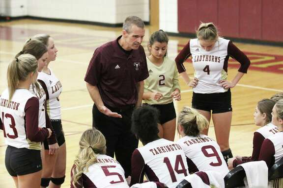 Tarkington first-year head coach Troy Errington gives his Lady Longhorns some instruction on the sideline during a timeout. Errington logged his first win as they defeated Dayton, 3-0.