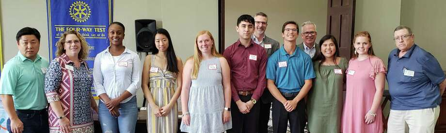 The Rotary Club of Katy recently recognized its 2019 Katy Independent School District Scholarship recipients.  Fourteen students were honored with $27,500 in scholarships.  Funds for these scholarships were raised primarily from the KatyTriathlon at Cane Island and the Katy Rice Festival. From left are: Scotty Jung, president Katy Rotary; Vicki Rao, Rotarian- Scholarship co-chair; Mrs. Disla-Forde, representing her daughter and scholarship recipient Gabriella Disla-Forde of Katy; Rachel Wang of Seven Lakes; Katherine Haley of Cinco Ranch; Derick Del Rio of Cinco Ranch; Jeff Stocks, assistant superintendent for School Leadership Support Secondary; Zachary Gammons of Taylor; Steve Robertson, assistant superintendent for School Leadership Support Secondary; Sarah Rodriguez of Katy; Kate Fuqua of Katy and Harold Bennett, Rotarian- Scholarship co-chair.  Other winners of scholarships not pictured are: Kianna San Felix of Mayde Creek; Nawaf Abulhaija of Morton Ranch; Tarini Thiagarajan of Tompkins; Nkemasom Nwadei of Seven Lakes; Siarah Mazariegos of Katy; Kayla James of Katy; and Tori Conner of Katy. Photo: David Frishman/Rotary Club Of Katy / David Frishman/Rotary Club Of Katy