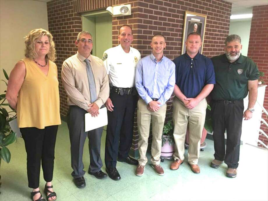 Newest New Milford Police Department Officers Mark Bove and Richard Descoteaux, with Mayor Pete Bass, right, Chief Spencer Cerruto, center, Personal Director Greg Bollaro and Town Clerk Noreen Pritchard, left. Photo: Contributed Photo / / The News-Times
