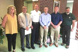 Newest New Milford Police Department Officers Mark Bove and Richard Descoteaux, with Mayor Pete Bass, right, Chief Spencer Cerruto, center, Personal Director Greg Bollaro and Town Clerk Noreen Pritchard, left.