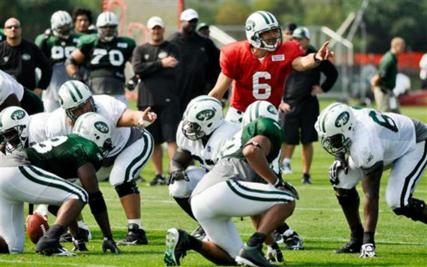 New York Jets quarterback Mark Sanchez (6) directs the offense during morning practice at the team's NFL football training camp in Cortland, N.Y., Tuesday, Aug. 3, 2010. (AP Photo/Kevin Rivoli)