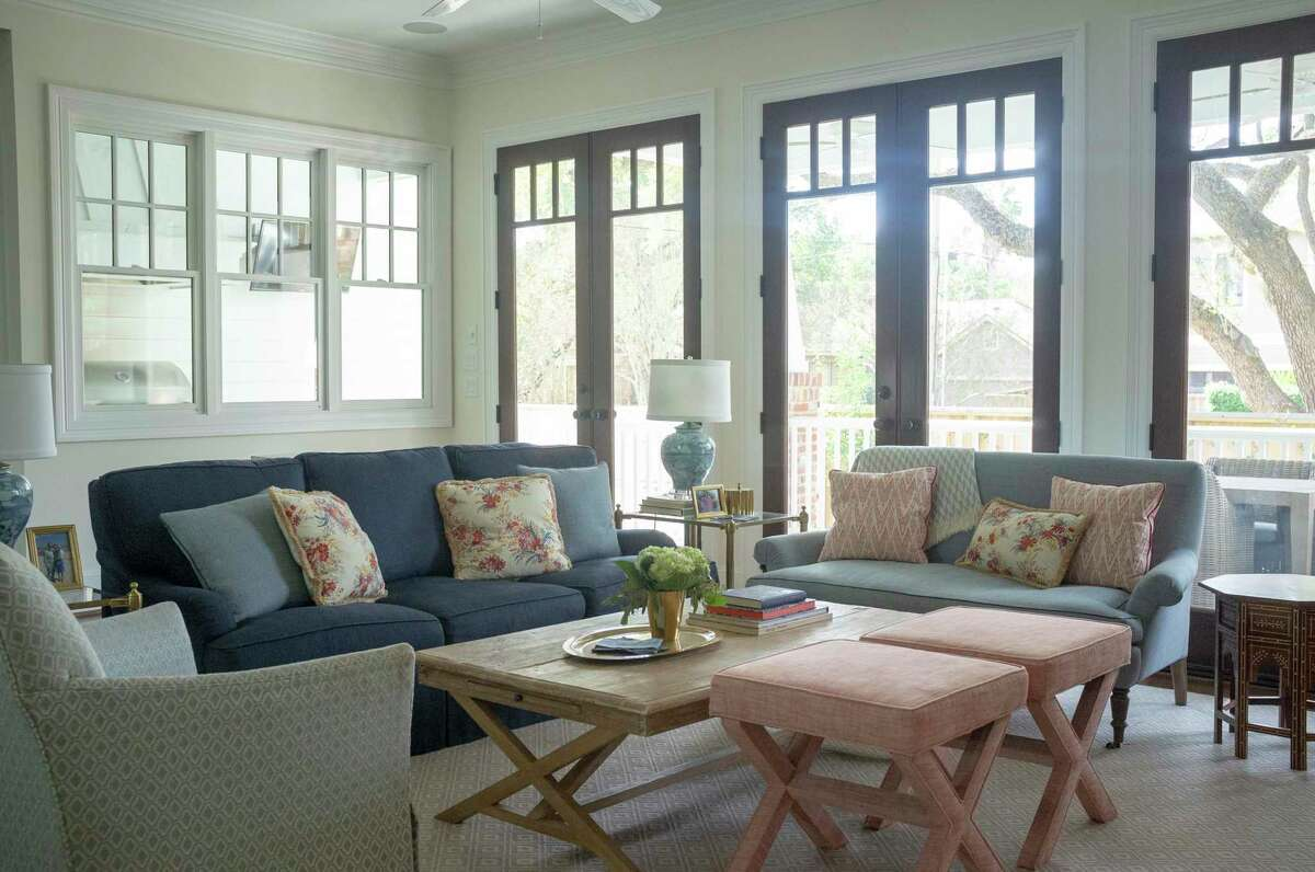 Though the center of the home -- the family room, kitchen and breakfast area -- feels neutral, Gabe and Bridget have strong elements of red and blue.