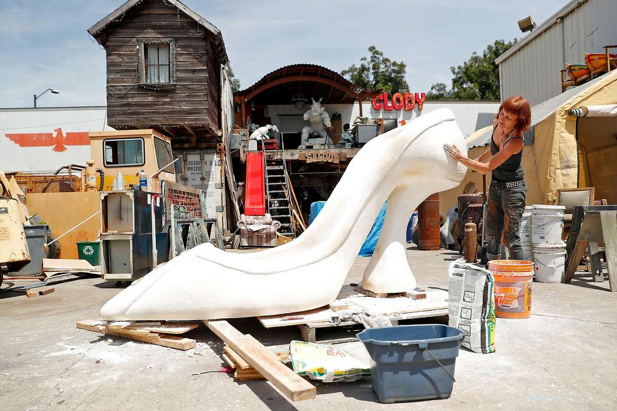 Artist Clody Cates works on a sculpture at NIMBY Collective warehouse in Oakland, Calif., on Monday, August 5, 2019.