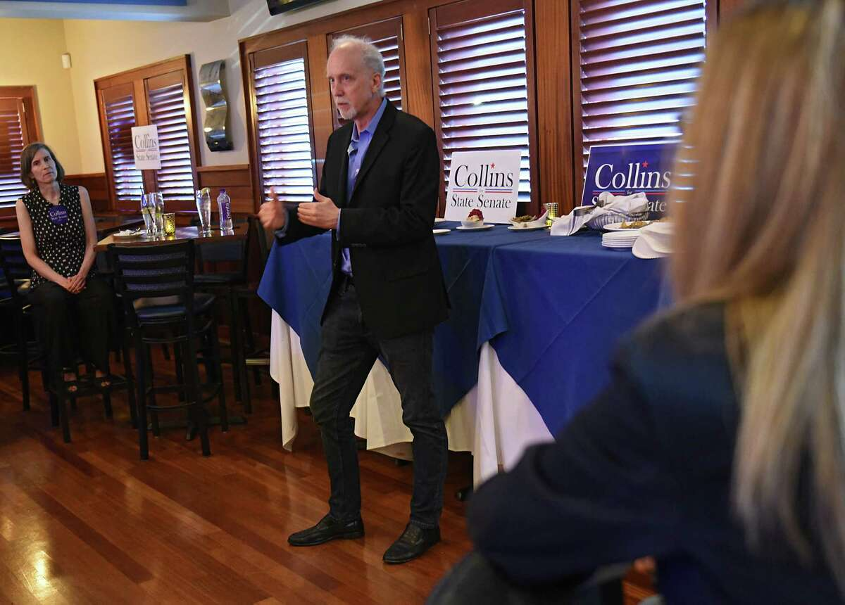 Jeff Collins, Woodstock resident and activist, who is running for the Democratic nomination for New York State?•s 46th Senate District, holds the second of five campaign launches at Athos restaurant on Thursday, Aug. 8, 2019 in Guilderland N.Y. His wife Lisa is seen at left. (Lori Van Buren/Times Union)