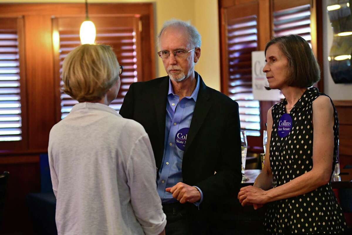 Jeff Collins, Woodstock resident and activist, stands next to his wife Lisa, right, as he talks to Fran Porter who is running to represent the county legislature?•s 31st District during a campaign launch at Athos restaurant on Thursday, Aug. 8, 2019 in Guilderland N.Y. Jeff Collins is running for the Democratic nomination for New York State?•s 46th Senate District. (Lori Van Buren/Times Union)