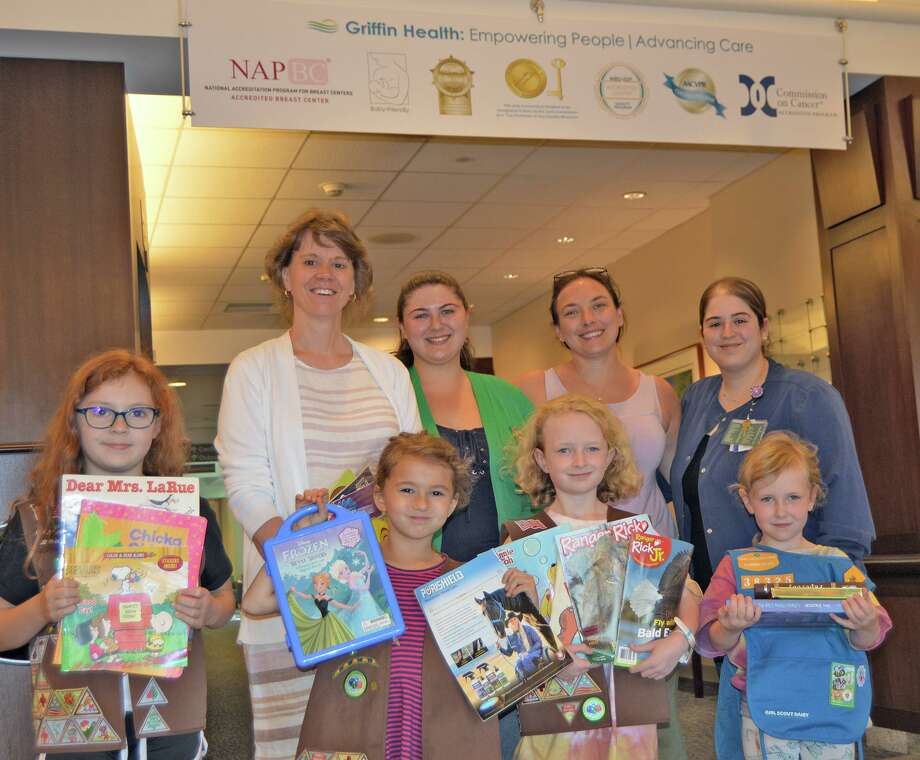 Brownie and Daisy Scouts from Girl Scout Troops 38392 and 38325 recently donated children's books, magazine and toys to Griffin Hospital's Emergency Department. Photo: Contributed Photo.