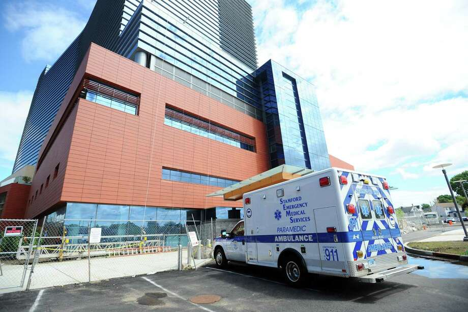 An ambulance waits at Stamford Hospital. Photo: Michael Cummo / Hearst Connecticut Media / Stamford Advocate