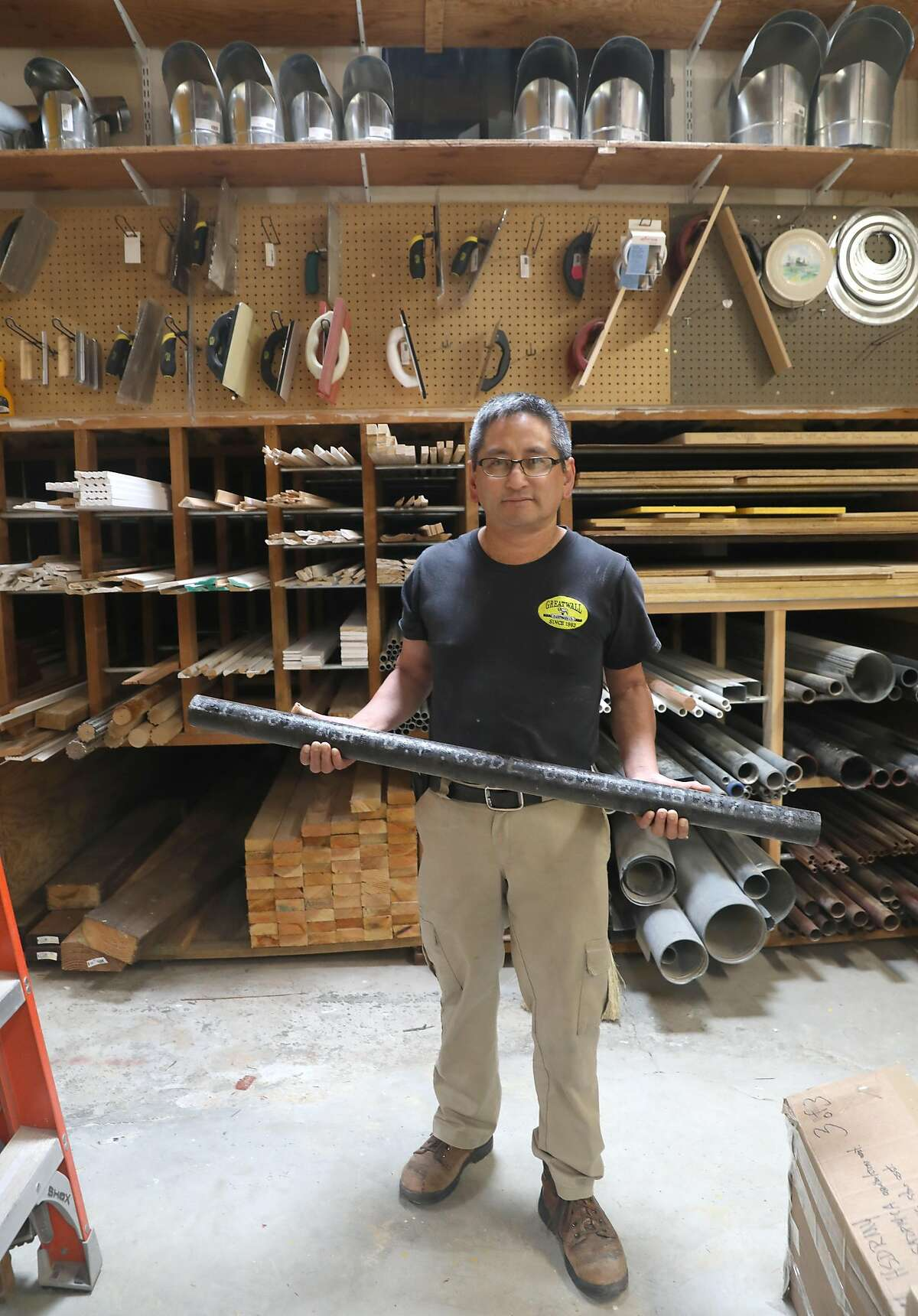 Owner Albert Chow shows a cast iron pipe from china which he originally buys for 21$ dollars which he sells for 31$ dollars at Great Wall hardware store that he and his family owned since 1983 on Thursday, Aug. 8, 2019 in San Francisco, Calif. He now must buy the pipe for 31$ dollars because of china tariffs.