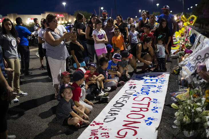 Xsquad and the Hit Squad baseball teams prepared a banner with their handprints honoring the victims of the El Paso shooting Wednesday, Aug. 7, 2019, in El Paso. Xsquad's coach Memo Garcia was shot and has been undergoing surgeries. His wife Jessica Coca Garcia was shot on her legs and has been released from the hospital.