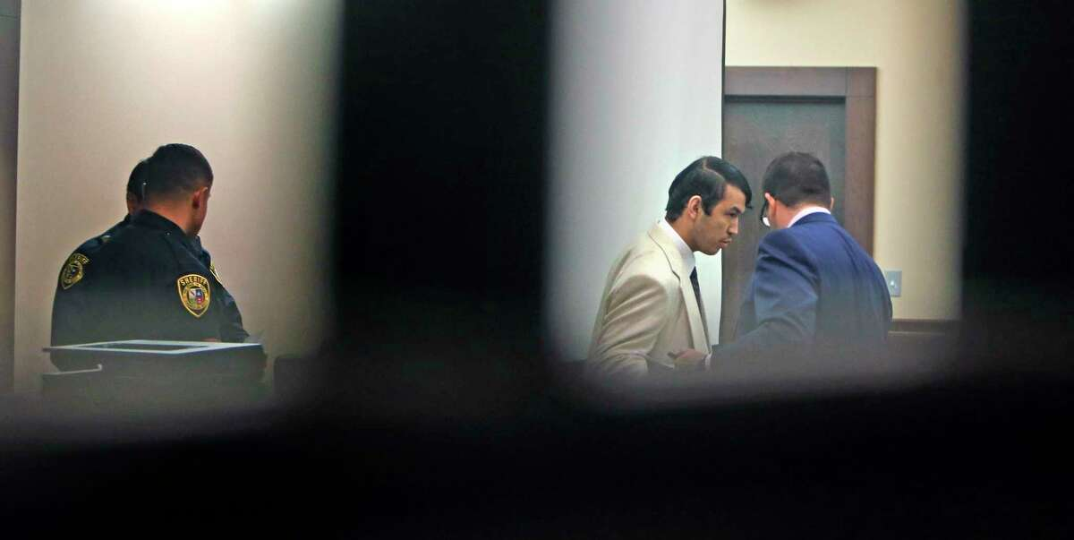 Miguel Martinez is led into the courtroom Friday. A jury found him guilty of killing UTSA graduate student Laura Carter in 2015.