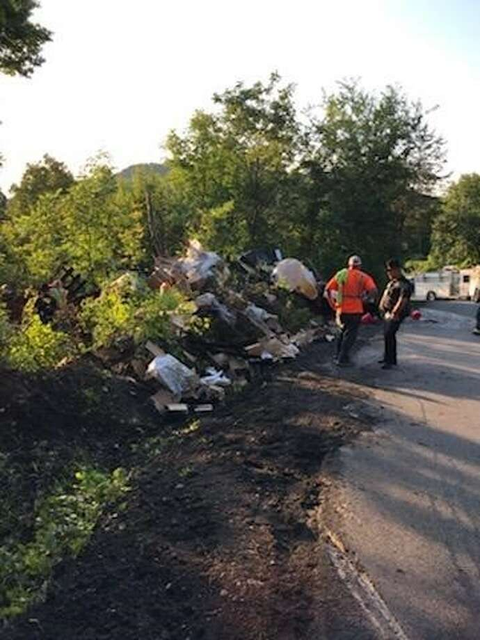 A truck and trailer crashed Aug. 9, 2019 on Cass Hill Road in New Scotland. Two people were injured and some hazardous materials spilled. Photo: Albany County Sheriff