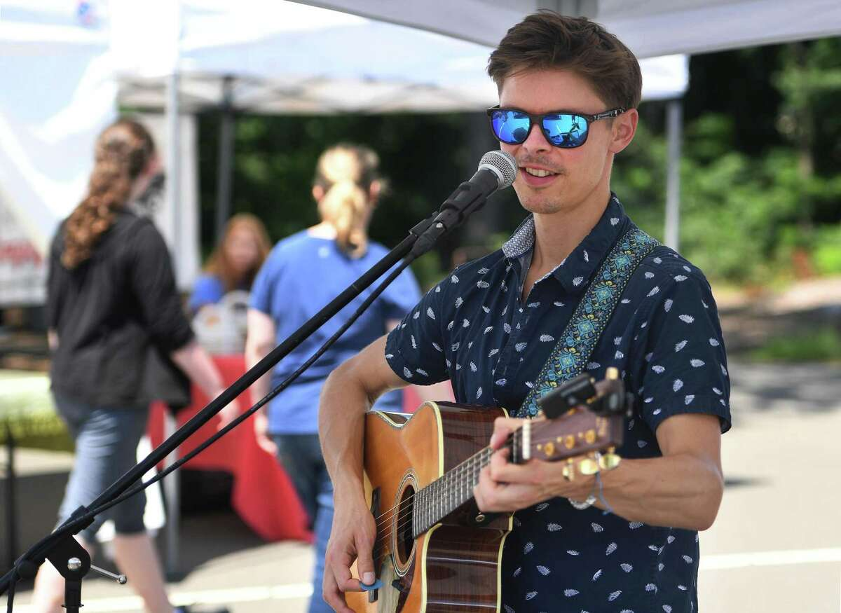 Billy Ruegger, of Fairfield, entertains on vocals and guitar at the weekly Westport Farmers' Market at 50 Imperial Avenue in Westport on Aug. 1. The market is open Thursdays from 10 am until 2 pm.