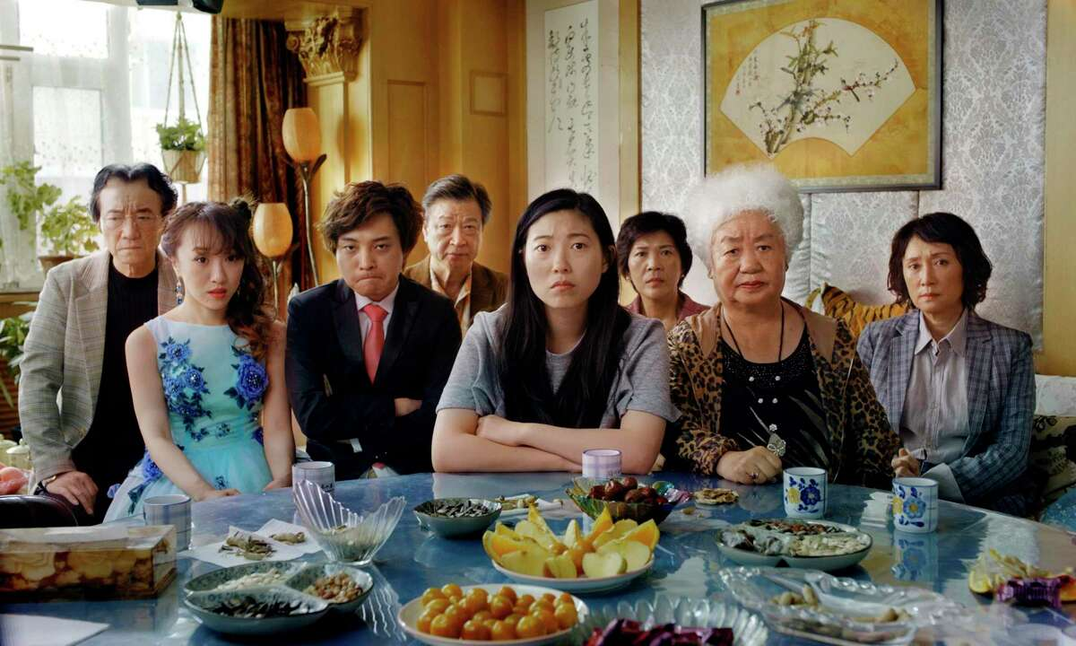 This image released by A24 shows Awkwafina, center, in a scene from