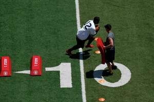 Mike Ford #12 of LSU participates in position drills during the XFL Summer Showcase at TDECU Stadium in Houston, TX on Saturday, June 8, 2019. The XFL has started to send out invitations for players to declare for its October 2019 draft. The league's season will start in February 2020.
