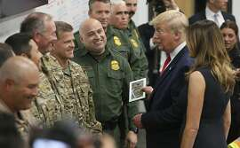 President Donald Trump and first lady Melania Trump talk with Border Patrol agents at the Office of Emergency Management, Wednesday, Aug. 7, 2019, in El Paso, Texas. Trump visited El Paso to meet with those who were wounded in the mass shooting at Walmart and first responders who were at the scene. (Mark Lambie/The El Paso Times via AP)