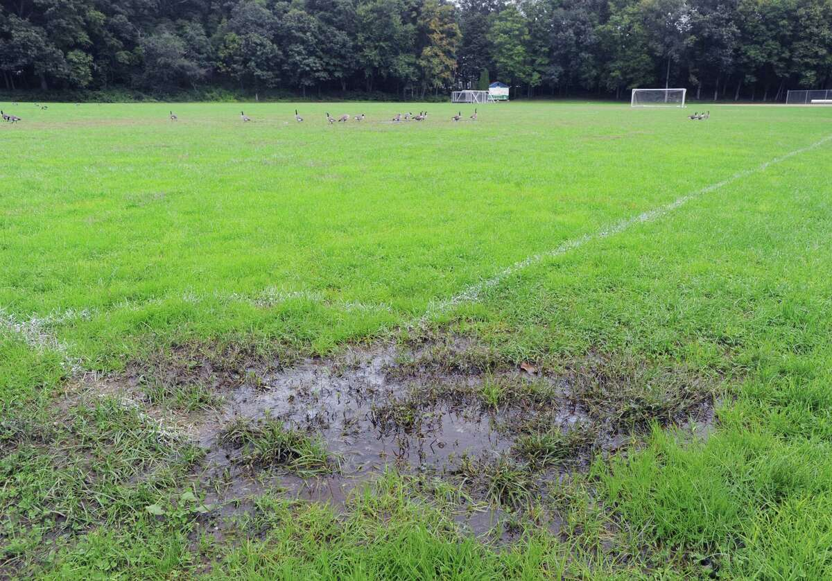 A soggy and muddy athletic field at Central Middle School in Greenwich, Conn., Thursday, Oct. 4, 2018.