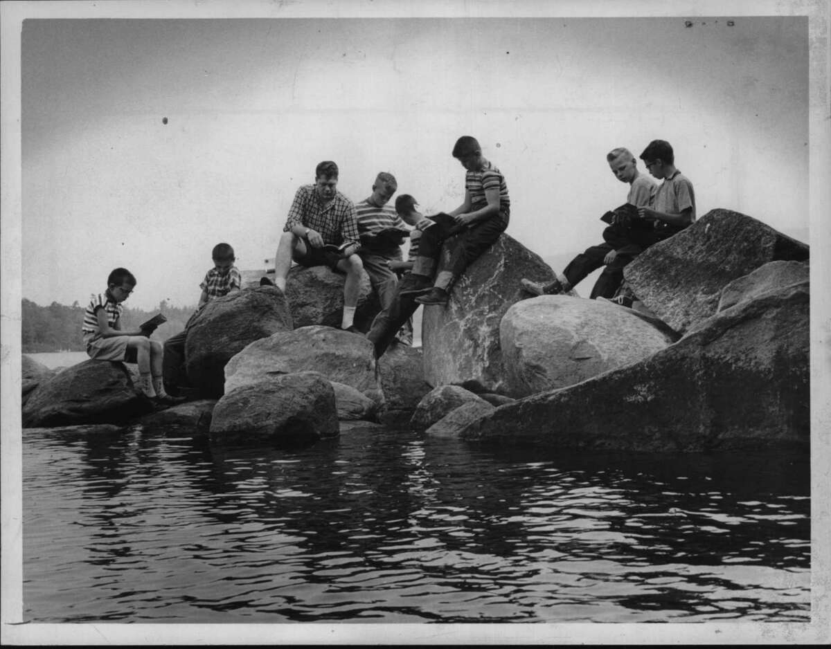 Canoeing, swimming, crafts, sports, music and more summer camp activities have been a staple of a New York summers for ages. Click through the slideshow to see what summer camp looked like in upstate New York in the 1960s, 70s and 80s. James Reed teaches class on waterfront at Camp Fowler in New York. Undated (Knickerbocker News Staff Photo/Times Union Archive)