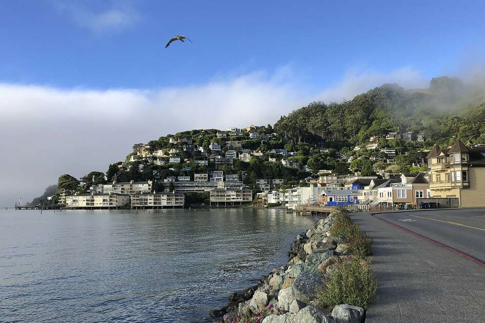 In this photo taken July 11, 2019, fog appears behind the hills of Sausalito, Calif. A school district in one of California's wealthiest counties has agreed to desegregate a flailing school that state officials found was intentionally created for low-income minority children. California Attorney General Xavier Becerra said Friday, Aug. 9, 2019 that the Sausalito Marin City School District outside of San Francisco must develop a plan, scholarship program and counseling for students of Bayside Martin Luther King Jr. Academy. (AP Photo/Eric Risberg)