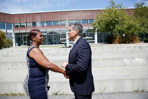 Sausalito Marin City school district Board of Trustees president Ida Green (l to r) and California attorney general Xavier Becerra shake hands after a press conference at Bayside Martin Luther King, Jr. Academy, where it was announced that the Sausalito Marin City School District agrees to end segregation in its schools on Friday, August 9, 2019 in Sausalito, Calif.