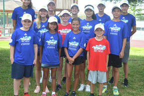 Some of the ball kids for the Edwardsville Futures pose for a photo before the start of first-round singles matches in the main draw on Wednesday morning at the Edwardsville High School Tennis Center.