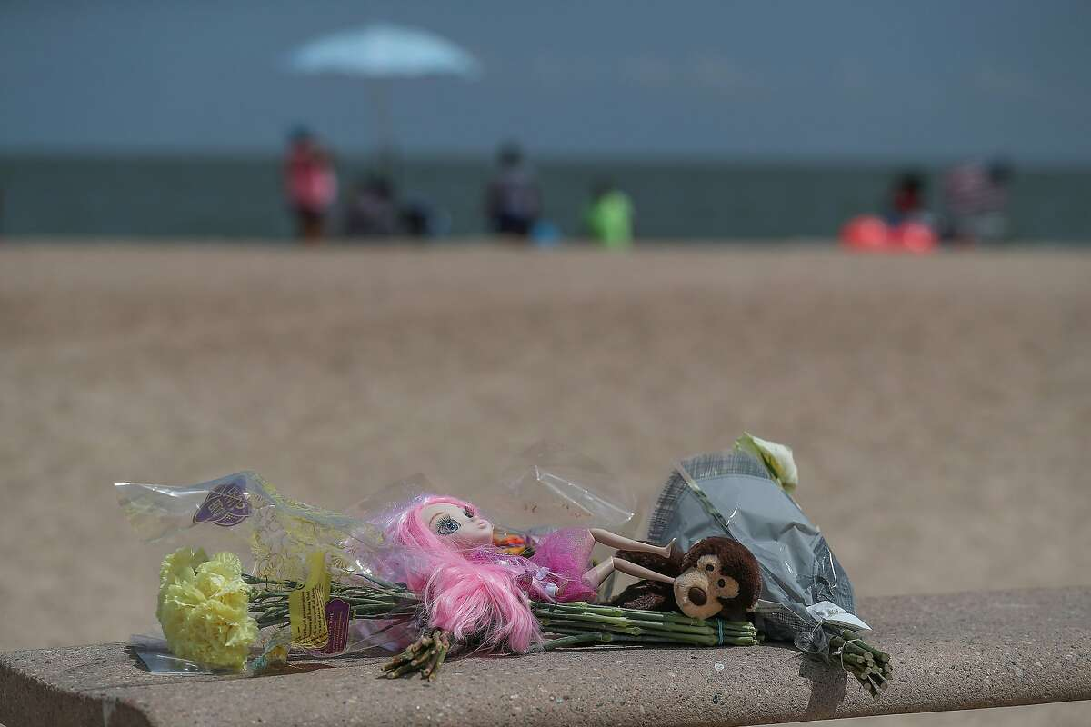 """One of two small memorials near the area where Three siblings drowned Thursday night at Sylvan Beach Park in La Porte while playing in """"choppy"""" waters, officials said Friday, Aug. 9, 2019, in La Porte. A fourth child - the eldest sibling in the family - was pulled from the water and taken by ambulance to the nearest hospital, said Harris County Sheriff Ed Gonzalez."""