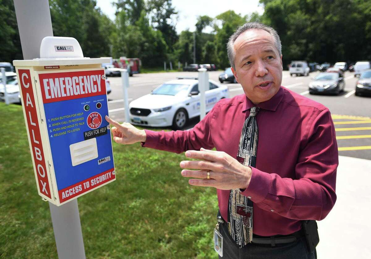 Sacred Heart University Deputy Chief of Public Safety Ed Shea shows one of the emergency blue light call boxes located around the campus in Fairfield on Thursday.