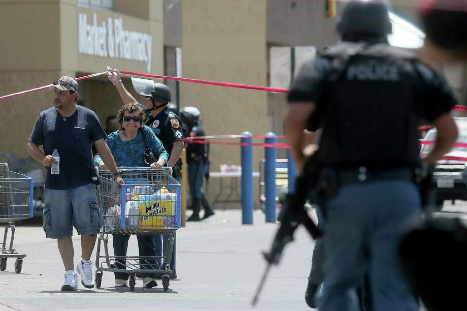 Walmart customers are escorted from the store after a gunman opened fire on shoppers near the Cielo Vista Mall in El Paso, Aug. 3. A reader is afraid to go shopping following the shooting. Photo: Mark Lambie /Associated Press / ONLINE_YES