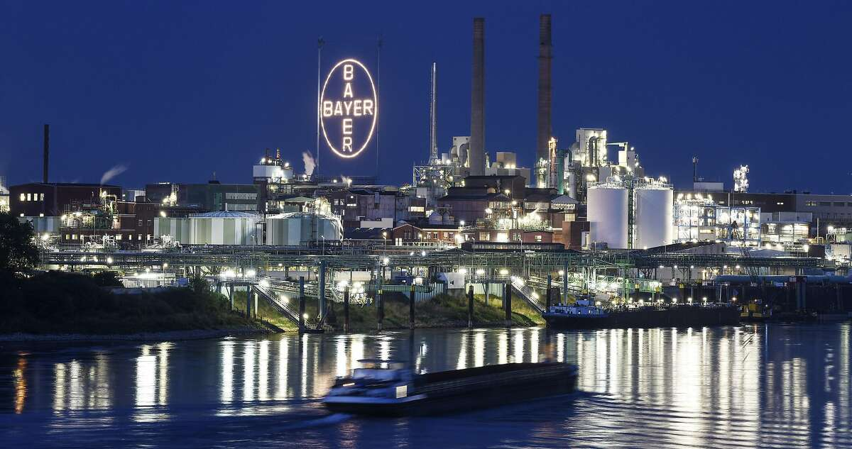 A ship passes the main chemical plant of German Bayer AG on Thursday, Aug. 9, 2019 in Leverkusen, Germany. The company faces about 18,400 lawsuits against subsidiary Monsanto over its glyphosate-based weedkiller Roundup in the United States. Bayer acquired Monsanto for $63 billion last year.