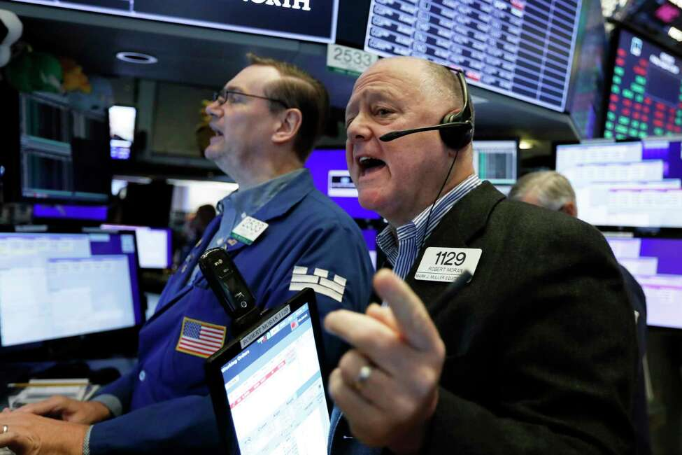 Trader Robert Moran, right, and specialist Patrick King work on the floor of the New York Stock Exchange, Friday, Aug. 9, 2019. Stocks moved broadly lower in early trading On Wall Street Friday as investors again retreated to safer holdings in a market racked by fear and anxiety over trade disputes. (AP Photo/Richard Drew)