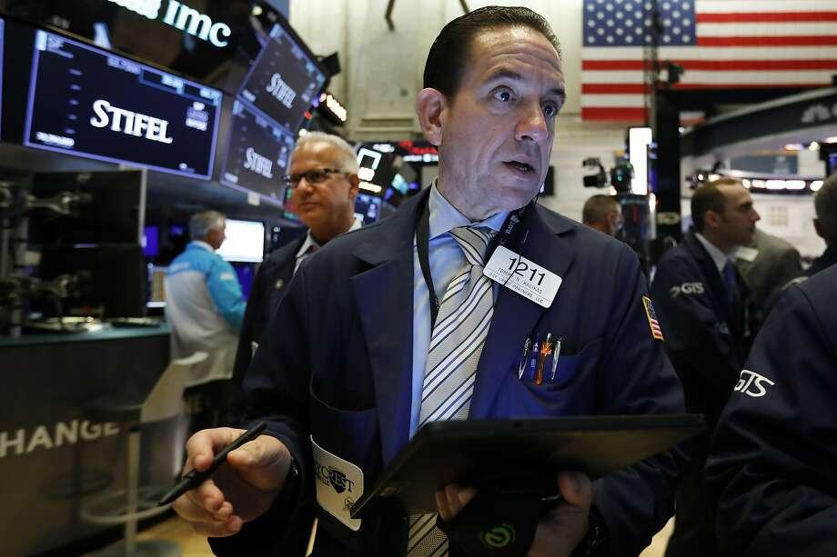 FILE - In this Aug. 6, 2019, file photo trader Tommy Kalikas works on the floor of the New York Stock Exchange. The U.S. stock market opens at 9:30 a.m. EDT on Friday, Aug. 9. (AP Photo/Richard Drew, File) Photo: Richard Drew, Associated Press