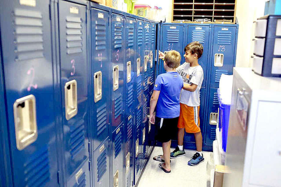 Kayden Frankford, left, and Owen Manny, both third-graders at Columbus Elementary, check out the locker area of Mrs. Klenke's third-grade classroom Thursday. Photo: Photos By Marci Winters-McLaughlin | For The Intelligencer