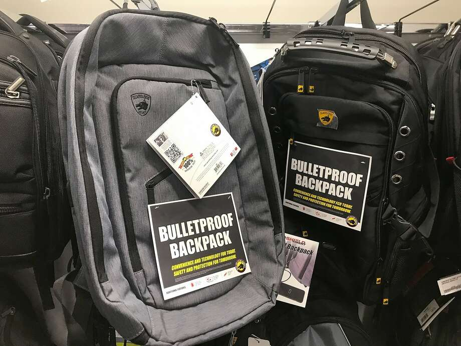 This Thursday, Aug. 8, 2019 photo shows bulletproof backpacks that for sale at an Office Depot store in Evanston, Ill..  With the rise of mass shooting, companies like Guard Dog Security, TuffyPacks and Bulletblocker are creating bullet-resistant backpacks for children for the back-to-school shopping season. Many say they're seeing an increase in sales in their products leading up to the fall, and typically see a spike in sales after a mass shooting. (AP Photo/Teresa Crawford) Photo: Teresa Crawford, Associated Press