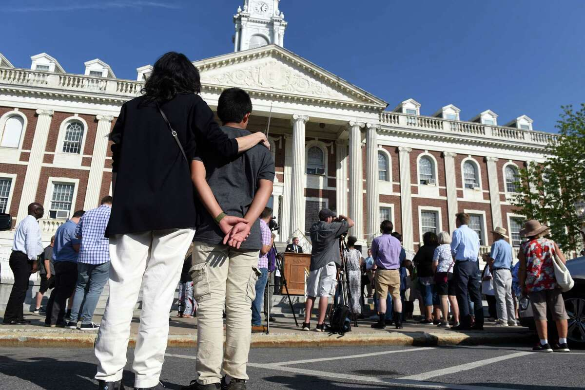 People gathered outside Schenectady City Hall to pay tribute to the victims of the mass shootings in El Paso, Texas, and Dayton, Ohio on Friday afternoon, Aug. 9, 2019, in Schenectady, N.Y. As of July 6, 2021, there will be heightened security, and people will not be able to freely walk in and out of City Hall. (Will Waldron/Times Union)
