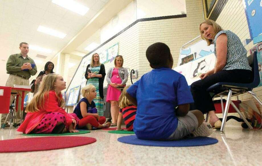 School districts in Montgomery County have been busy preparing for the first day of school, but with the opening of campus doors next week they've also been preparing to adopt several mandates passed down by House Bill 3 from the state— one of which is the requirement to offer full-day prekindergarten. Here, teachers observe a Conroe ISD training at an orientation seminar. Photo: File Photo / File Photo