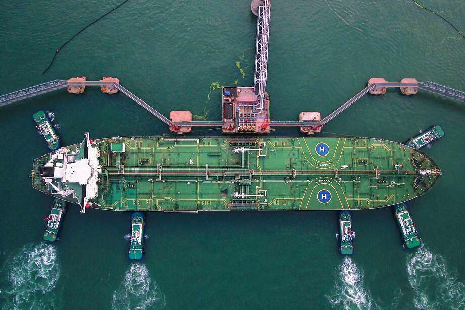 TOPSHOT - This aerial photo taken on August 4, 2019 shows tugboats berthing an oil tanker at Qingdao port in Qingdao in China's eastern Shandong province. Photo: Str, AFP/Getty Images