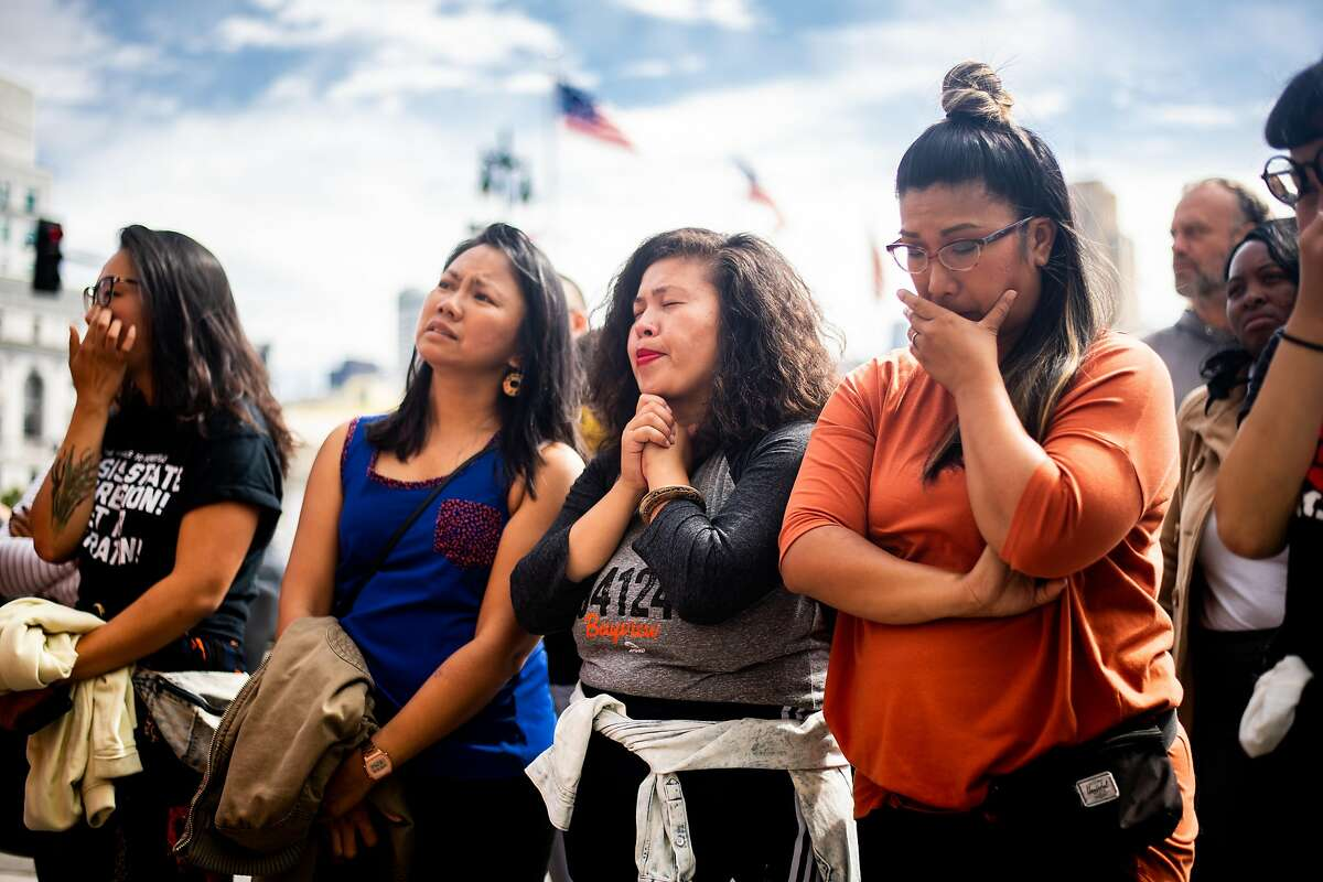 Alexis David, center, and fellow friends of Brandon Lee rally outside San Francisco City Hall on Friday, Aug. 9, 2019, in San Francisco. Lee, an activist and community organizer, was shot outside his home in the Philippines, according to friends.