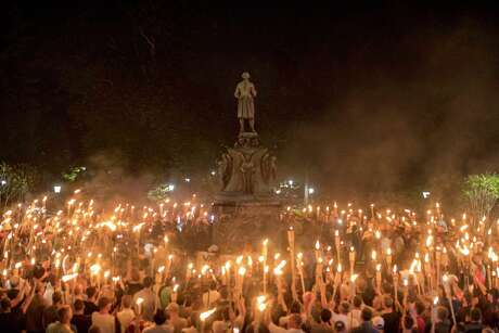 FILE-- Torch-bearing white nationalists rally around a statue of Thomas Jefferson near the University of Virginia campus in Charlottesville, Aug. 11, 2017. After the El Paso shooting in 2019, there are calls to give the government more tools to address attacks motivated by white supremacy. But there are questions about how such legislation would work. (Edu Bayer/The New York Times)