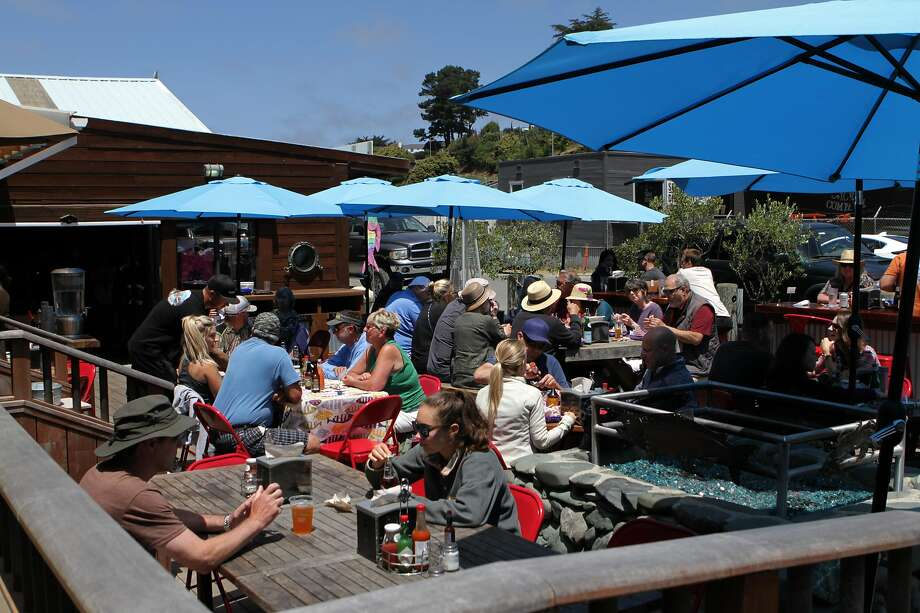 Diners crowd the patio at Princess Seafood Market & Deli, which sells local fish and seafood alongside Noyo Harbor in Fort Bragg. The city of Fort Bragg, named after Confederate Gen. Braxton Bragg, will consider changing its name. Photo: Sarah Feldberg