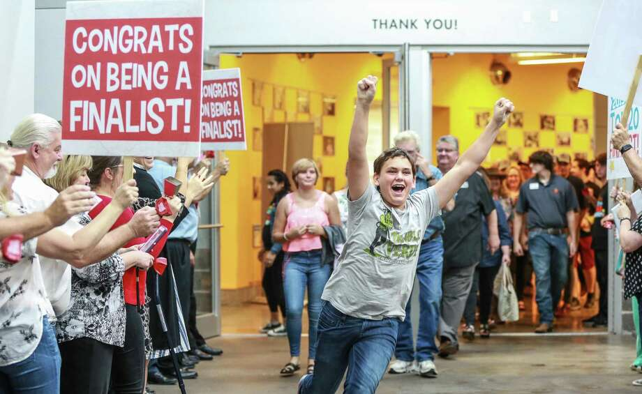Luke Johannson,14, explodes in joy that 3 Sons Foods LLC won grand prize at the H-E-B Quest for Texas Best statewide food competition on Thursday, Aug. 8, at the Houston Food Bank. Luke, his mother and two brothers founded the sauce company together because they wanted to step up their efforts raise funds for rhino conservation. Photo: Courtesy Photo By H-E-B / Kelley Sweet Photography