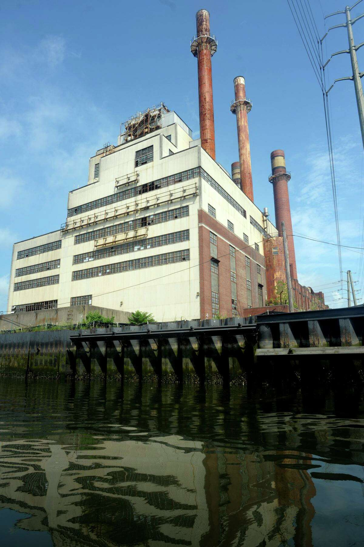 English Station, the abandoned power station, seen from the Mill River in New Haven Aug. 7, 2019.