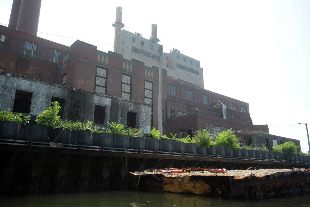 English Station, the abandoned power station, seen from the Mill River in New Haven, Conn. Aug. 7, 2019.